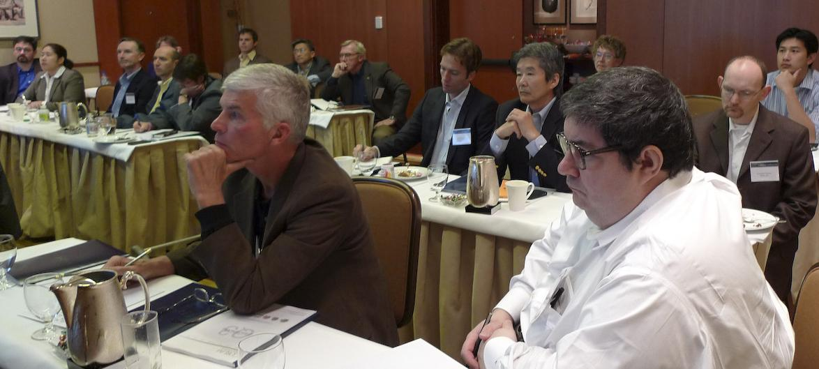 Craig Sirnio and Sean Murphy sitting in front row of a sobering merger and acquisition briefing by Nate Burgess